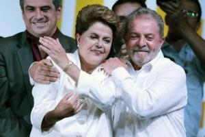 Former president Lula da Silva congratulates Brazil's President and Workers' Party presidential candidate Rousseff after disclosure of the election results, in Brasilia